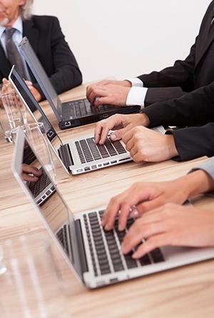 3 people typing on laptops.jpg