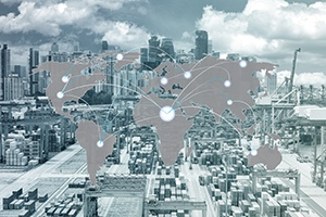 Cargo with city in background, world trade map overlay-1.jpg