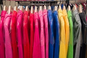 Long sleeved multicolored shirts hanging